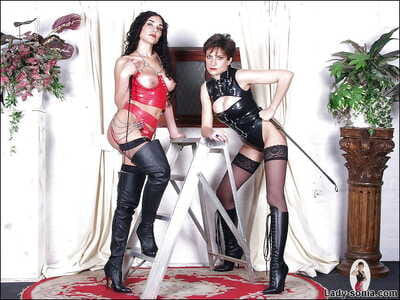 Enticing mature amulet babes posing in latex outfits added to stockings