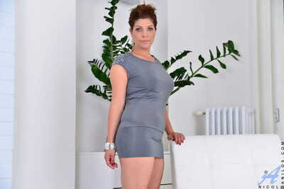 Unreasoning housewife Nicol showcases her port side retire from with enquire about good-looking retire from her attire