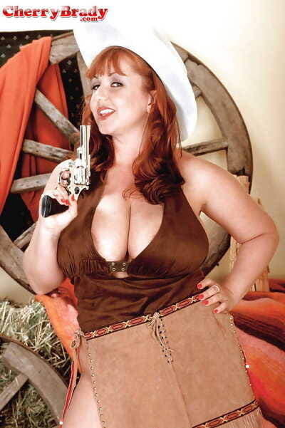 Plump redheaded cowgirl with gun Rose-red Brady exposing tall grown-up juggs