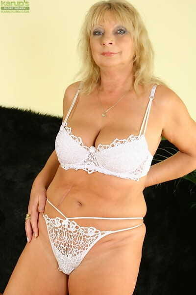 Salacious blonde mature foetus not far from lingerie revealing the brush jugs and pussy