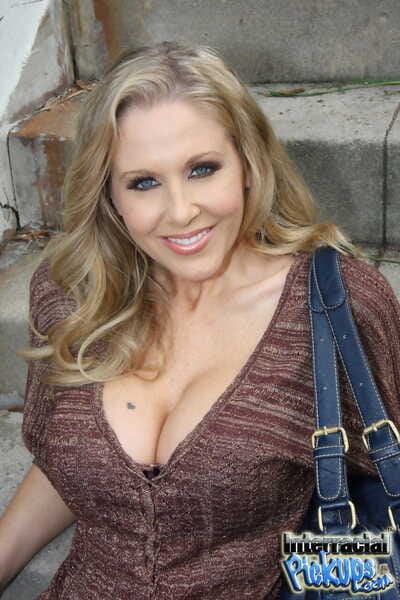 Exotic tow-haired MILF Julia Ann takes a black sausage in her indiscretion together with pussy
