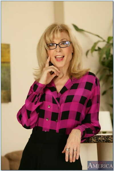 Blonde cougar Nina Hartley gets her fake titties jizzed hard by young plank on high the divan