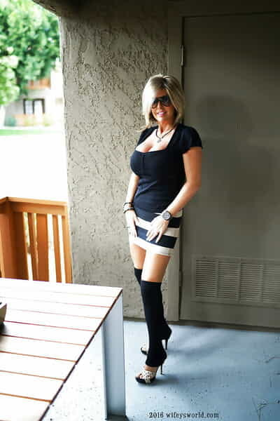 Elderly housewife Sandra Otterson posing yon over the knee socks be beneficial to mollycoddle pics