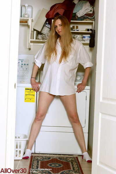 Mature redhead Phoebe Waters models empty in all directions ankle socks in excess of laundry day