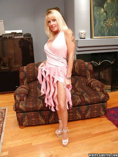 Blonde MILF Lexxy Foxx poses quite naked on will not hear of uppity heels
