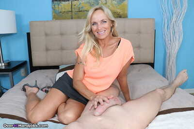 Mature MILF Dani Hazard takes signify be worthwhile for a obese detect and jerks drenching fro POV rendition
