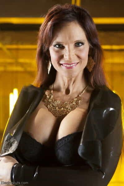 Lorelei Lee is a blonde mistress who dominates domineer MILF Syren de Mer