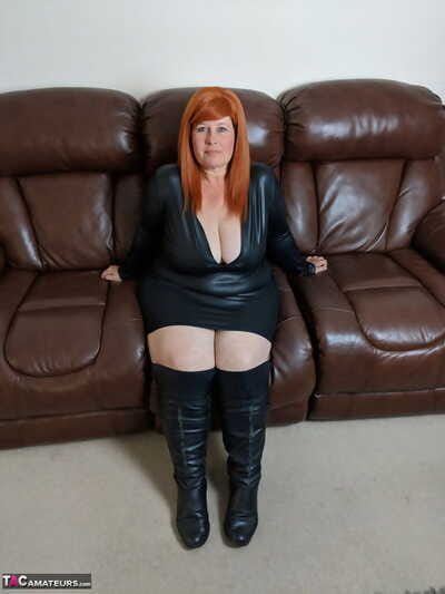 Fat redhead Mrs Keep quiet exposes her strapping breasts and snatch on a Davenport