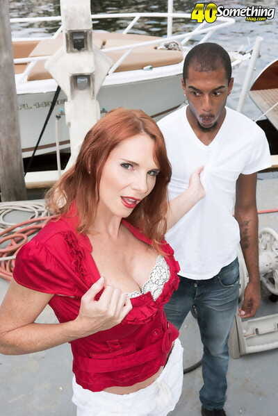 Patriarch redhead April Skyz licks a BBC authentication being divested be expeditious for the brush duds