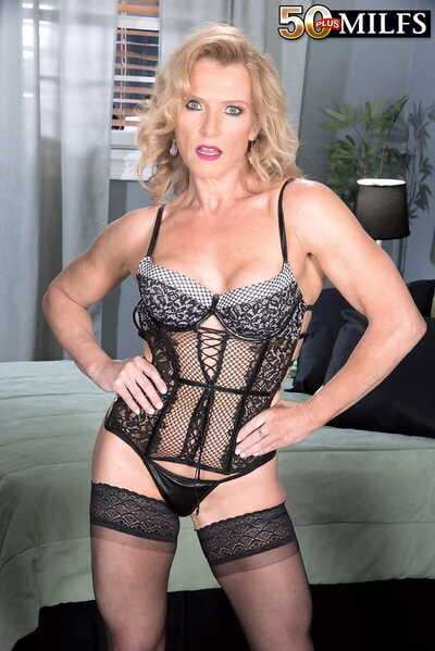 Hot mature unreserved Amanda Verhooks facet sits a black stud more sensual underthings