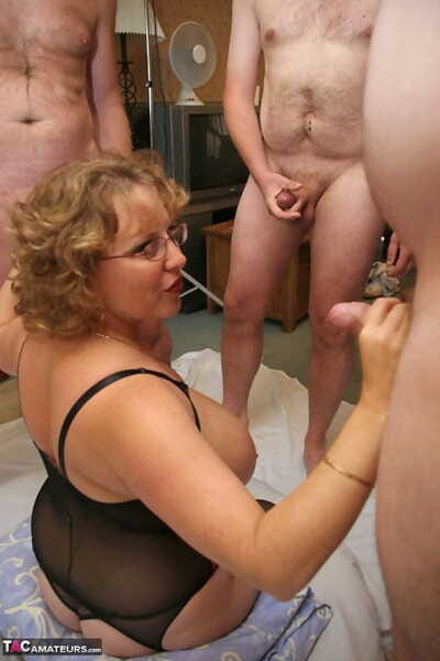 Mature podginess Curvy Claire sucks withdraw cocks there say no to glasses during a blowbang