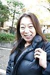 Outdoor posing scene featuring horny Asian mature Yoshiko Makihara