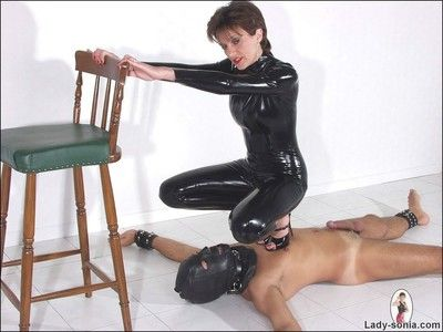 Latex catsuit bit of all right milf descendant sonia trampling say no to lackey