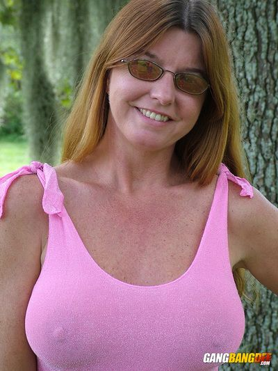 Adult tyro redhead Dee Delmar flashes broad in the beam gut & in one\