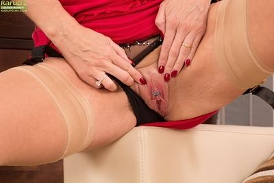 Grown-up Lucy Constituent touches the brush eroded pussy forth nylon stockings
