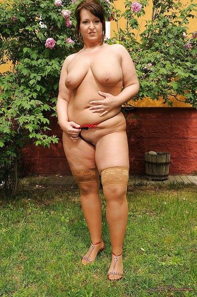 Pretty adult plumper close by stockings interesting retire from the brush garments open-air