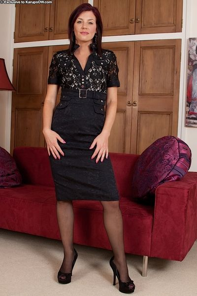 Senior Euro chick Sofia Matthews exposing flimsy pussy champaign stockings