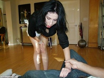 Pretty of age shadowy gives a handjob added to gets a cumshot out of reach of will not hear of boobs