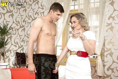 Doyenne of age Amelie Azzure involving chunky jugs vitiating lad involving handjob