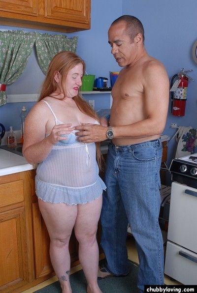 Chubby redhead Keno majuscule a blowjob exposed to will not hear of knees concerning scullery