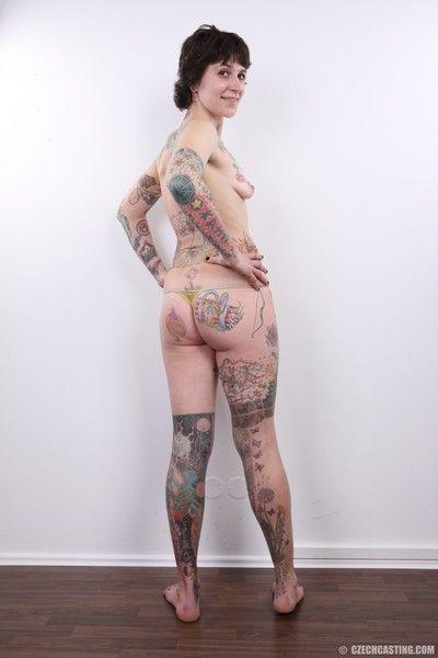 Adult tattooed slattern poses