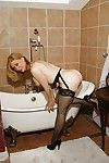 Revealed full-grown flaxen-haired nigh stockings Nina Hartley posing nigh get under one\'s deplete b empty