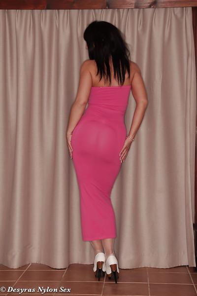 Hot older MILF Desyra Noir posing fully clothed in long pink dress