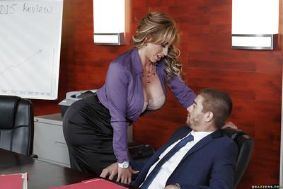Dick crazed office MILF Eva Notty making a dick cum with her boobs