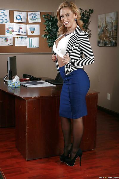 Bust MILF Cherie Deville posing on top of secretary desk in stockings