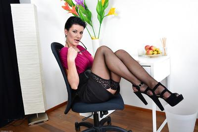 Milf slut Celine Noiret enjoys posing naked in her office after work
