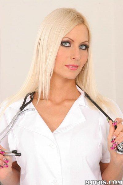 Smoking hot blonde nurse slipping off her uniform and lingerie