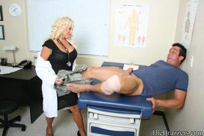 Big titted doctor Savanah Gold gives a titjob and rides on a cock