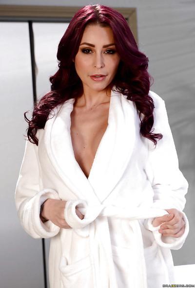 Beautiful redheaded MILF Monique Alexander undressing for nude photos