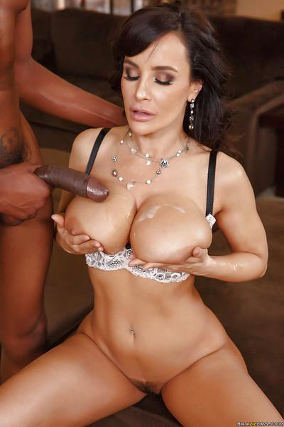 Stunning curvy MILF Lisa Ann enjoying a huge black cock in her cunt
