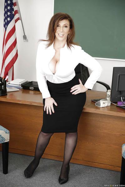 Stocking clad MILF teacher Sara Jay freeing huge juggs from lingerie