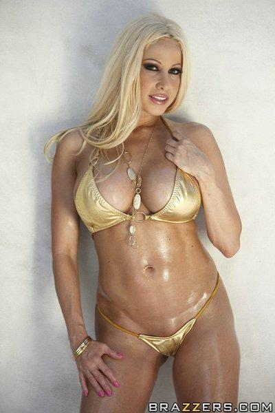 Sexy MILF in golden bikini Gina Lynn masturbates outdoor by the pool