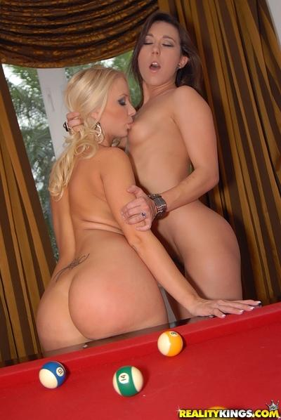 Lesbian MILFs licking pussy and using a strap-on on the pool table