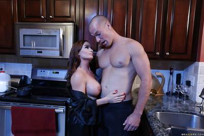 MILF pornstar Diamond Foxxx covers large tits with milk in kitchen