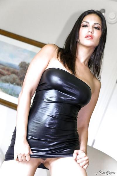 Indian pornstar Sunny Leone reveals her big tits in a latex skirt