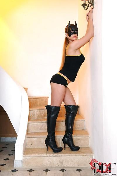 Sassy knockout in sexy cosplay outfit pleasing herself with a vibrator