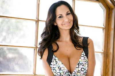 Busty MILF Ava Addams spreads pussy and flashes huge natural breasts