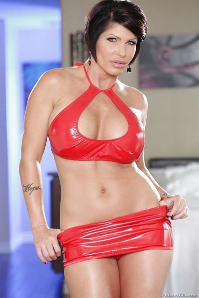 Brunette milf with huge titties Shay loves to undress her latex