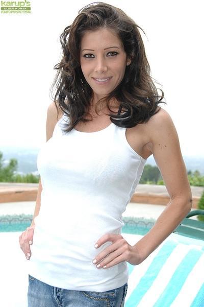 Brunette MILF Angel Little showing big boobs outdoors after bikini removal