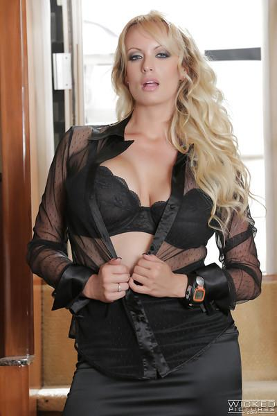 Busty blonde pornstar Stormy Daniels stripping out of skirt to spread pussy
