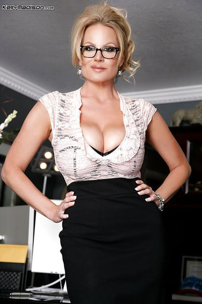 Amateur office milf Kelly Madison is posing in sexy high heels