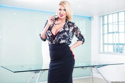 Busty blonde office worker in glasses strips off skirt and blouse