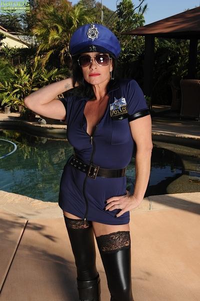 Babe model Braxton Kai models outdoors in policeman