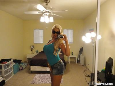 MILF babe with huge tits Bridgette B makes amateur shots of herself