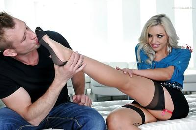 Gorgeous blonde chick Nina Elle jerking cock with nylon adorned feet