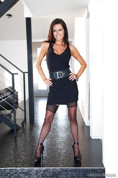 Kind milf with big tits Veronica Avluv poses half naked in high heels